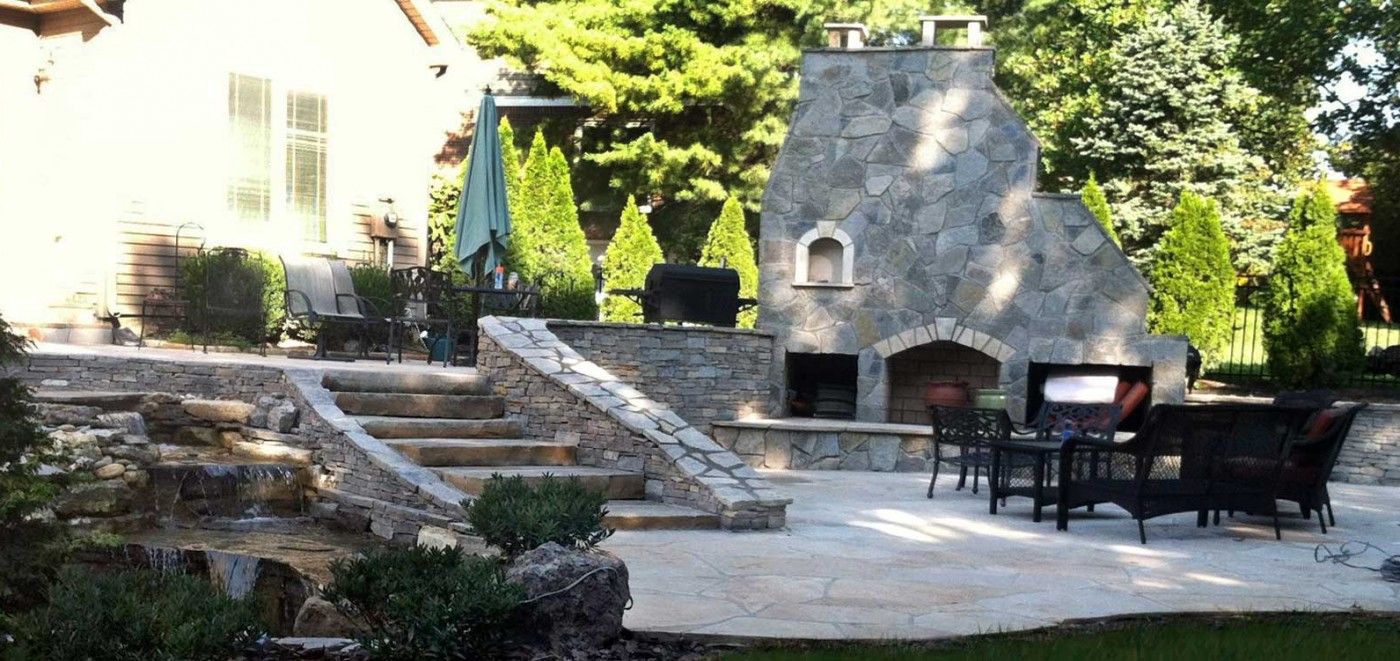 Amazing-Stone-and-hardscaping-patio-with-water-fall-and-koi-pond