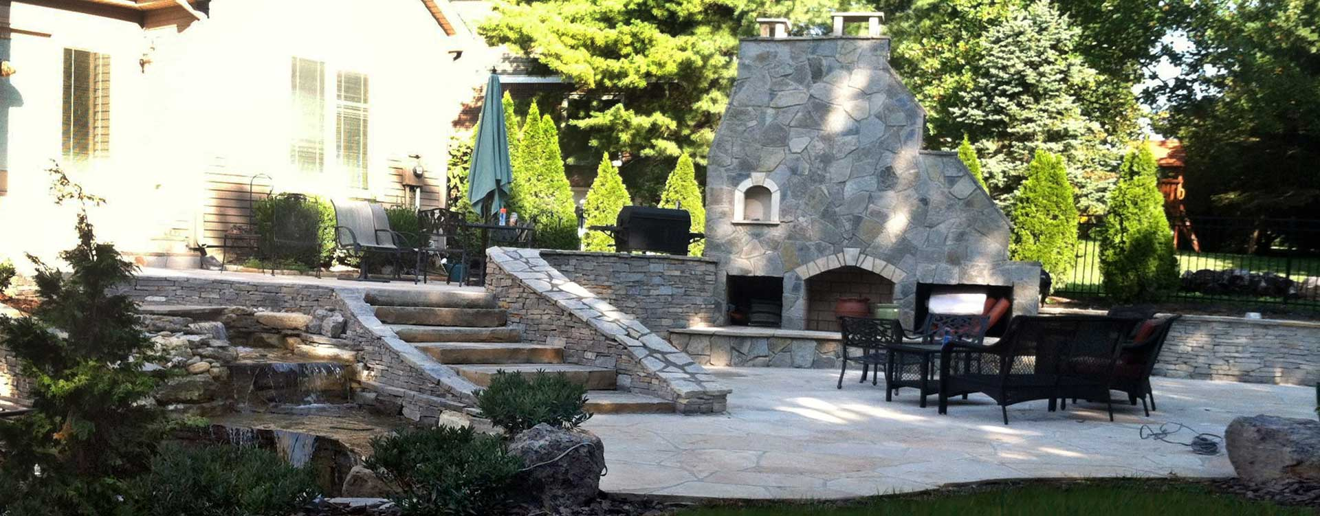 Amazing Stone And Hardscaping Patio With Water Fall And