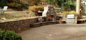 Stone-retaining-wall-and-stone-fireplace