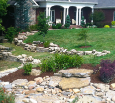 Stone hardscaping running through backyard